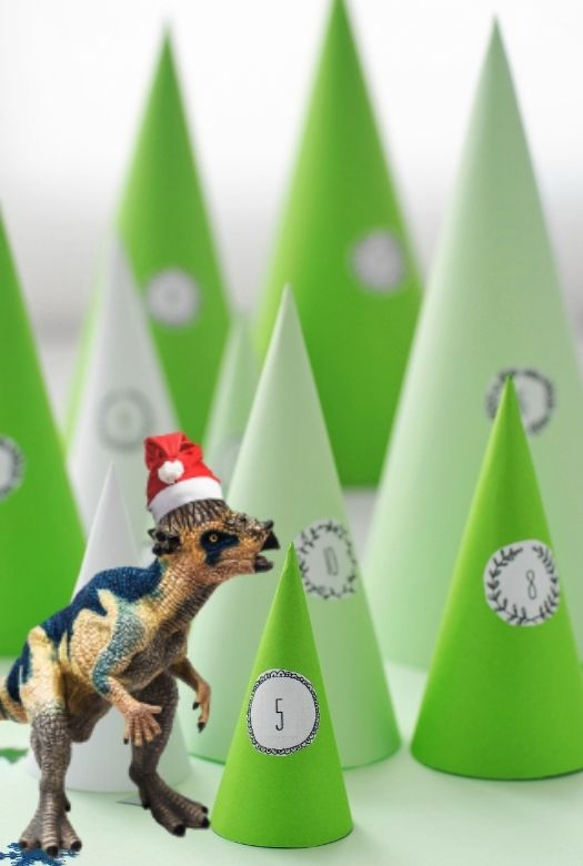 How to make your own dinosaur advent calendar - with examples such as this forest of trees with dinosaurs