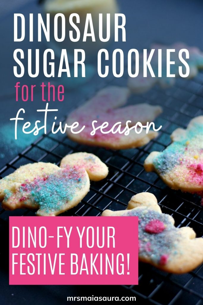 Pin: delicious dinosaur sugar cookies for the festive season: dino-fy your festive baking! With festive dinosaur sugar cookies cooling on a wire rack