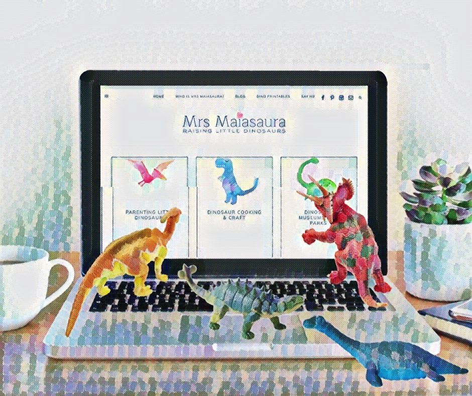 4 toy dinosaurs navigating the Mrs Maiasaura website on a laptop, in line with the terms of use