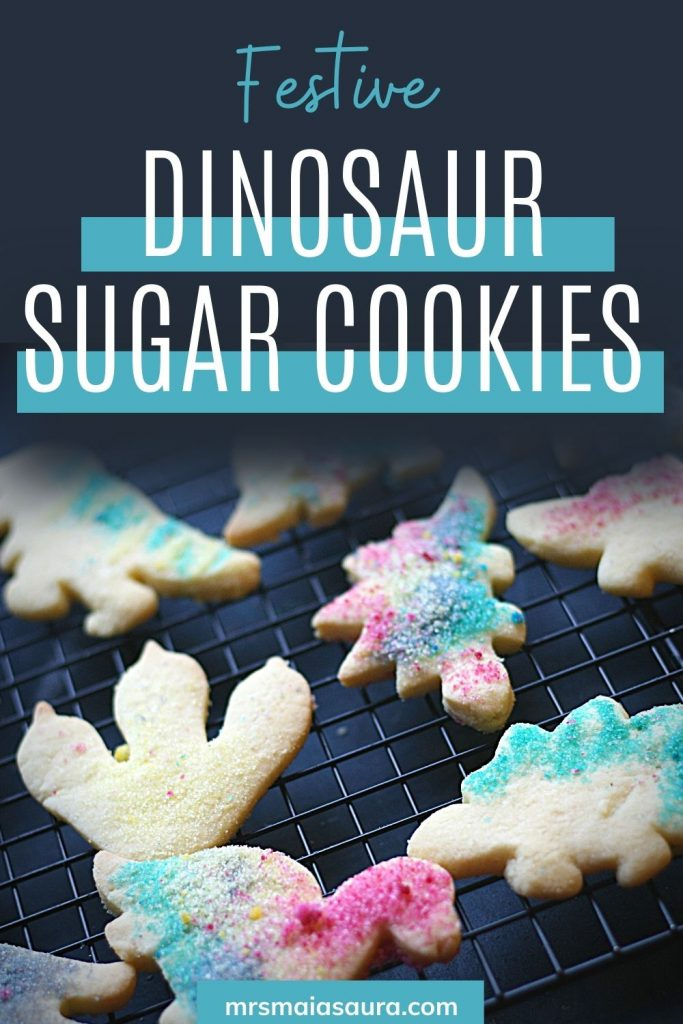 PIN: Festive dinosaur sugar cookies with homemade edible glitter, delicious cookies cooling on a wire rack before being gobbled up