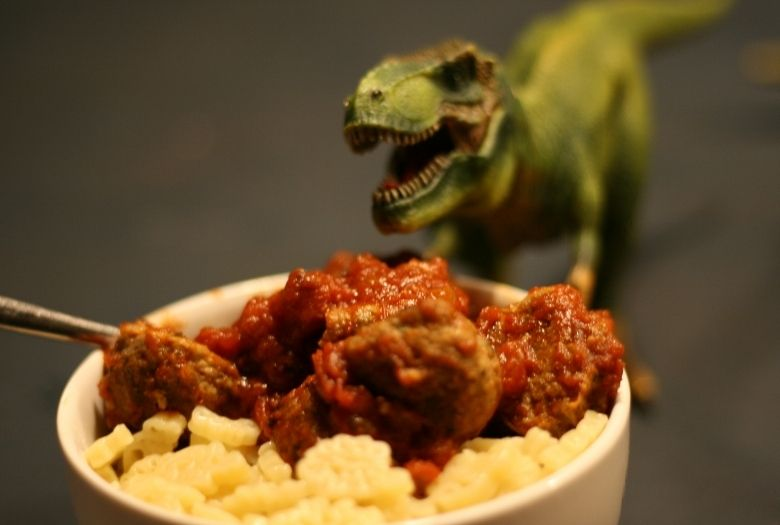 Pasta night: Meteorite Meatballs in marinara sauce, served with dinosaur-shaped pasta and a hungry toy T-rex