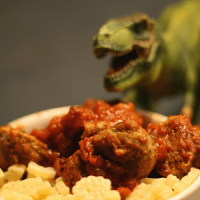 Meteorite meatballs with marina sauce and dinosaur-shaped pasta (with a T-rex looking on hungrily)