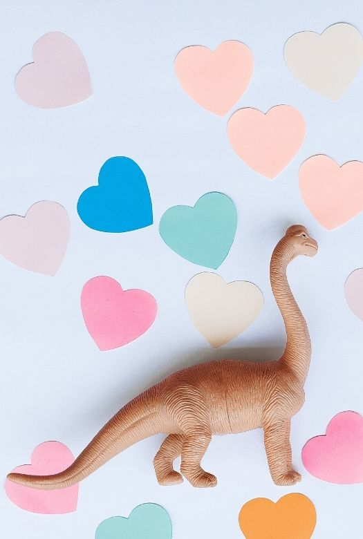 Fre dinosaur Valentine's Day cards, with toy Brachiosaurus and paper hearts