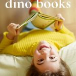 Pin: 19 fun dino books, with image of a child in a yellow to reading, photo taken from above