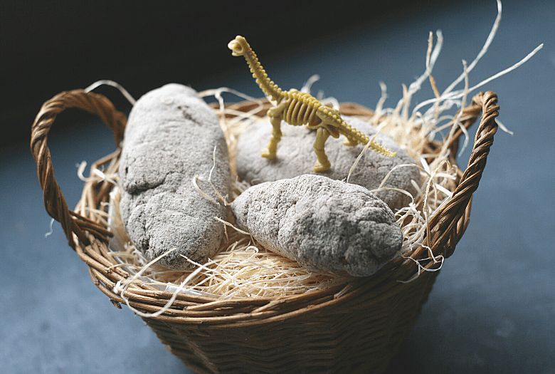 3 DIY dinosaur fossil eggs in a nest (basket) with a toy Brachiosaurus fossil