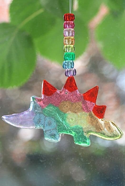 Gorgeous and simple dinosaur sun catcher (Stegosaur) hanging in the window